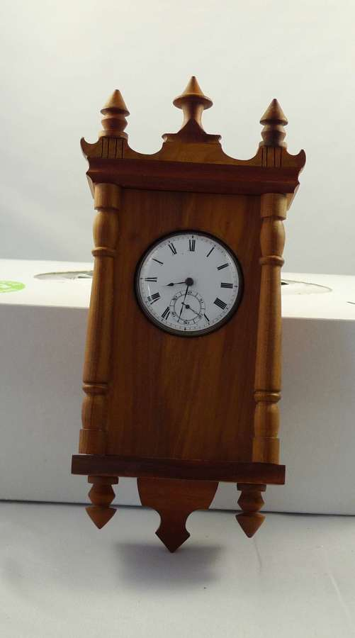 Olive Wood Watch Stand with a Silver Pocket Watch London 1862
